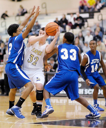 Lapel's Brady Cherry looks to pass as she is double teamed by APA's Lewis Gray and Tony Gillispie on Friday.