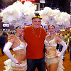 Greg Heitkamp, from Minster, Ohio, posed with these Las Vegas showgirls who were greeting  people during Hoosier Park Racing & Casino Las Vegas LIVE The Big Show New Year's Eve party Monday evening.