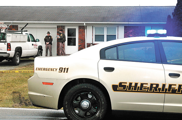 Madison County Sheriff's Department officers at the scene of a early morning shooting that left one person dead and another person in custody.  The shooting happened a little after 3:00 a.m. in the 6400 block of West CR 300S. just east of Lapel.