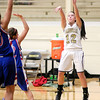 Daleville's Brynn Gooding shoots as the Broncos hosted the Elwood Panthers on Thursday.
