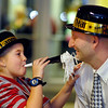 Breauna Taulbee, 9, celebrates with her father Guy Taulbee because he got married at the Chapel of Love at Hoosier Park Racing & Casino Monday evening.  The chapel was part of their Las Vegas LIVE The Big Show New Year's Eve party.