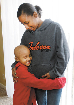 Johnathon Binnion, 5, and his mother Latoya Nance at their apartment in Anderson. Johnathon is undergoing treatment for brain cancer.