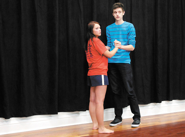 """Sarah King and Craig Doty rehearse their lines for a production of """"Murder Medium Rare"""" by the senior drama team at Alexandria-Monroe High School. Church Street Commons in Alexandria will be hosting the performance as it's first dinner theater this Saturday."""