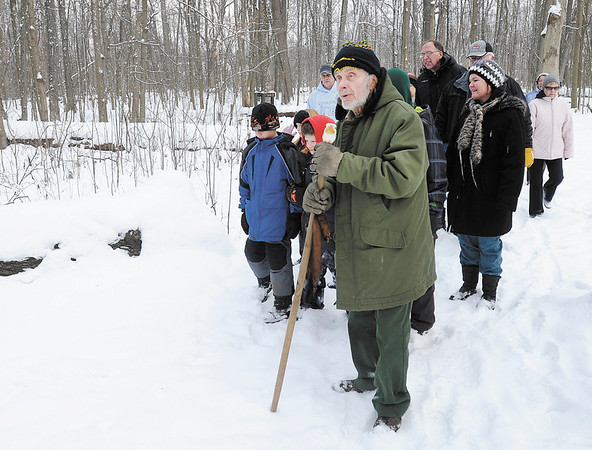 Mounds State Park naturalist Dwayne Hook leads a group of hikers on a tour of the Mounds on Tuesday.