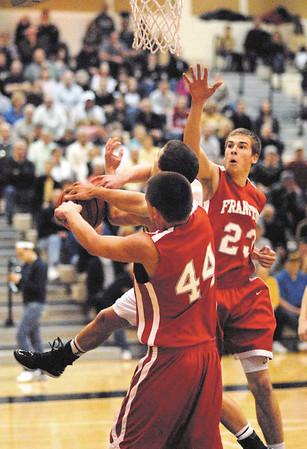 Frankton teammates Aaron Korn and Jordan Reeves battle Lapel  Bulldog Tanner Watkins of Lapel for a rebound.