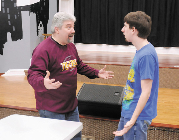 """Drama teacher Steve Fleck gives direction to Mitchell Kissick during a rehearsal for a production of """"Murder Medium Rare"""" by the senior drama team at Alexandria-Monroe High School. Church Street Commons in Alexandria will be hosting the performance as it's first dinner theater this Saturday."""