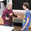 "Drama teacher Steve Fleck gives direction to Mitchell Kissick during a rehearsal for a production of ""Murder Medium Rare"" by the senior drama team at Alexandria-Monroe High School. Church Street Commons in Alexandria will be hosting the performance as it's first dinner theater this Saturday."