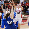 Frankton's Kelsey Key shoots as Tipton's Sarah Overdorf falls backwards as the Eagles hosted the Blue Devils on Thursday.