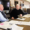 Tom Austin, left, former superintendent of Elwood Community Schools, works with outgoing superintendent Glen Nelson on his last day on the job Tuesday.  Austin will serve as interim superintendent for the next six months until a permanent replacement is found.