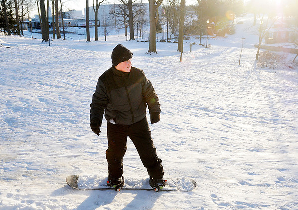 Matthew McCoy, 12, snow boards at Shadyside on Friday with his half-brother Johnny McCoy, not pictured. Temperatures are forecast to warm to near 40 next week.