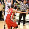 Madison-Grant's Tyler McClellan shoots from three-point range as the Argylls hosted the Liberty Christian Lions on Tuesday.