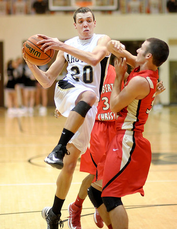 Madison-Grant's Jeremy Johnson drives to the basket against Liberty Christian's Austin Castor on Tuesday.