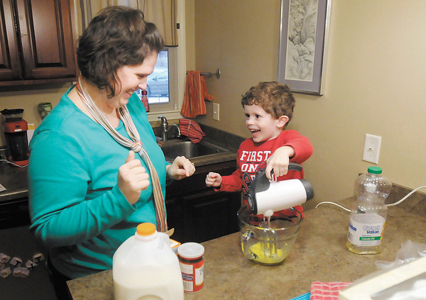 Gina Oldham and her son Fisher, 4, make waffles at their home on Tuesday January 15, 2013. The Oldhams use intentional play to teach their children lessons while they play.