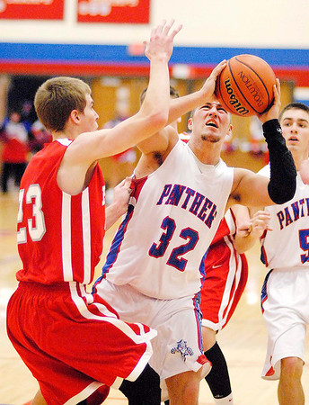 Elwood junior Jared Bourff drives through the foul during the Panthers home game against Frankton.