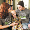 Van Green sits between his parents Kristi Krouse and Lukas Green. Van, 4, is battling brain cancer. A benefit concert and chicken noodle dinner to help pay for Van's medical costs are planned for January 20th at The Bridge Church.