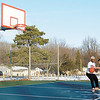 From left, Iquise Johnson, 16, and Bryant Swinford, 15, shoot some baskets on the courts at General Pulaski Park on Tuesday. A warm up is forecast for the area for the rest of the week.