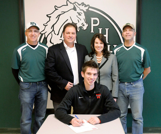 Pendleton Heights senior Graham McMullen signs a letter of intent to play tennis at Wabash College. Graham was awarded the Presidential Scholarship and plans to study Biology and Chemistry (pre-med). As a senior, Graham was selected to the first team All-State Academics and the 2012 Indiana Senior All-Star Team. Graham finished his career with a 66-11 overall record giving him the most wins and highest winning percentage in the history of PHHS tennis. Graham was also named The Herald Bulletin Player of the Year two years in a row, first team All County for four years, and first team All-District and All-State honors for three years. Standing from left are Dennis Poe, Todd McMullen, Holly McMullen and Royce Hammel.
