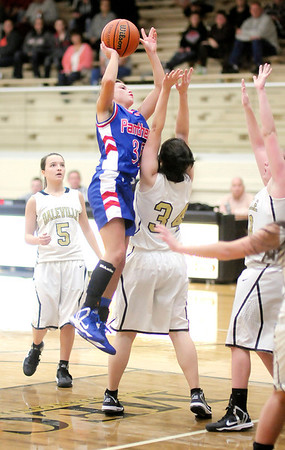 Elwood's Jessie Noone shoots as she is guarded by Daleville's Jordyn Marshel as the Broncos hosted the Panthers on Thursday.