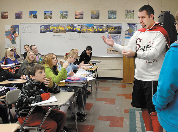 """As part of Daleville High School's homecoming activities this week it was Super Heroes day Thursday.  Dressed as the """"Super Wick"""" hero was Social Studies teacher and girl's basketball coach Jeff Wickersham.  Here teaching a 7th grade social studies class as his alter ego."""