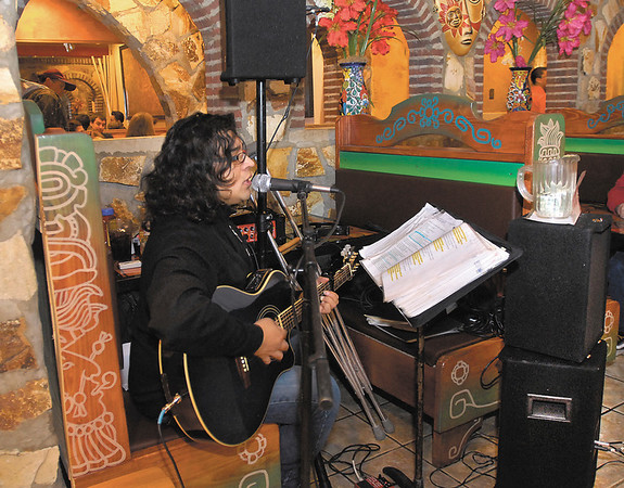 With a tip jar on top of his amplifier and crutches by his side TJ Sifuentes performs at Rivera Maya Restaurant for dinner guests.