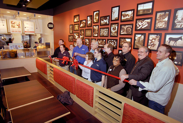 Qdoba management and local officials had a ribbon-cutting ceremony Monday for their grand opening.