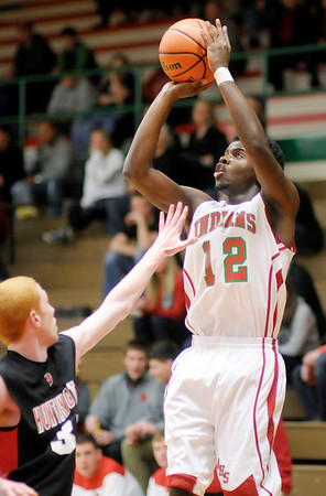 Anderson's Chris Lemon shoots as the Indians hosted the Huntington North Vikings on Friday.