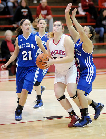 Frankton's Kaylee Irwin draws a foul from Tipton's Morgan Mahaney as she moves into lane to score as the Eagles hosted the Blue Devils on Thursday.
