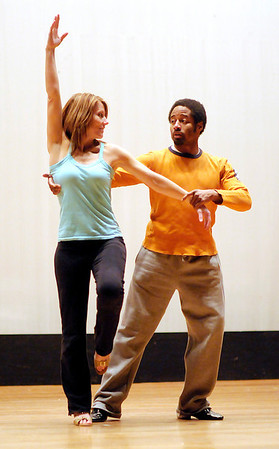 Erin Hacker practices with her dance instructor J.C. Bryant at the Paramount on Tuesday. The annual Dancing Like the Stars event is this Saturday at the Paramount.