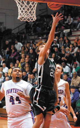 Pendleton's Nick Moore splits Elwood defenders Anthony Bennett and Griffin Hughes for an easy layup.