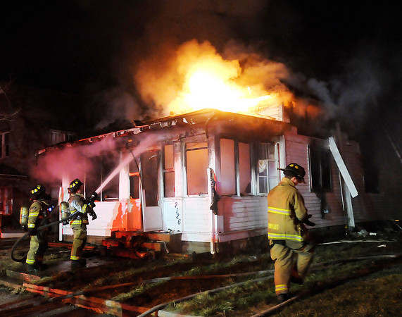 AFD fights a house fire at 2126 Fletcher Street on Wednesday evening.