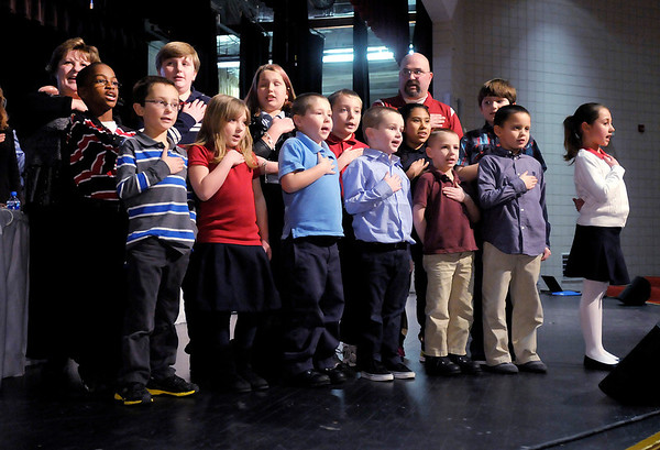 """Students from 10th Street Elementary lead the """"Pledge of Allegiance"""" at the start of the Anderson Community Schools Board Meeting on Tuesday. Students pictured include, Hannah Peckinpaugh, Logan Knight, Luke Gipson, Alexands Skinner, Tristan Davis, Brayden Stevenson, Elizabeth Case, Ashley Mendoza, Layne Davis, Connor King, Shaylee Kennedy, Graham Lonaker and Jordan White."""