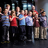 "Students from 10th Street Elementary lead the ""Pledge of Allegiance"" at the start of the Anderson Community Schools Board Meeting on Tuesday. Students pictured include, Hannah Peckinpaugh, Logan Knight, Luke Gipson, Alexands Skinner, Tristan Davis, Brayden Stevenson, Elizabeth Case, Ashley Mendoza, Layne Davis, Connor King, Shaylee Kennedy, Graham Lonaker and Jordan White."