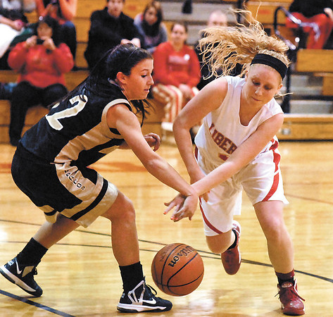 Daleville's Brynn Gooding fights for the loose ball against Liberty Christian's Briana Ayers.