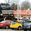 This NS train crosses Jackson Street and the downtown McDonald's restaurant as it works its way through downtown Anderson.