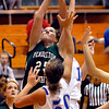 Pendleton's Taylor Siefken goes high for a rebound against Elwood's Tenasha Stephens and Kelsey Hughes.