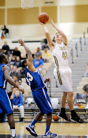Lapel's Drew Norton draws a foul from APA's Tony Gillispie as he scores from the low post on Friday.