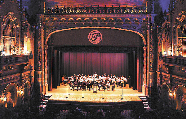 The Anderson Community Youth Choir sings a selection as part of the annual MLK city-wide celebration Monday held at the Paramount Theatre.