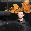 Anderson University sophomore Drew Brantley  framed in the Eternal Flame in front of AU's Decker Hall.  When Brantley's heart stopped he was revived by the use of a Automated External Defibrillator, or AED, new he tells his story to teach about the importance of AED accessibility.