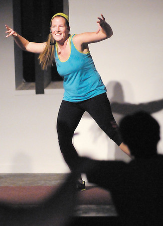 Whitney Jimenez is one of three instructors leading a Zumba class at Eastside Church of God on Thursday.