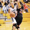 Pendleton Heights' Kelsee Wendling moves to the basket as she is guarded by Rushville's Sarah Cook on Saturday.