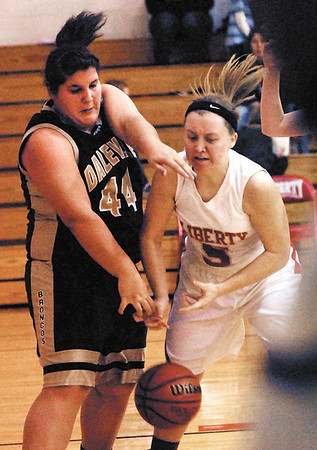 Daleville's Breanna Benner fights for the loose ball against Liberty Christian's Michaela Levell.