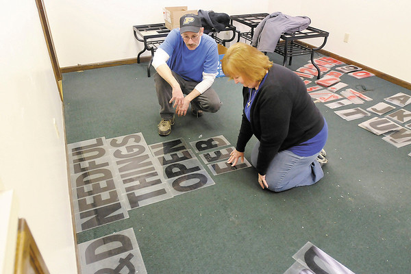 Barry and Dianna Hendricks, owners of B & D Needful Things find the letters for the sign at their new location to announce their opening on February 11th.