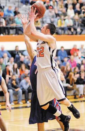 Anderson University junior guard Cody Jackson takes a shot from the foul lane.