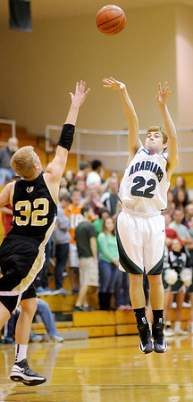 Pendleton's Nick Moore shoots from three-point range as he is guarded by Shelbyville's Reilly Reinbold on Saturday.