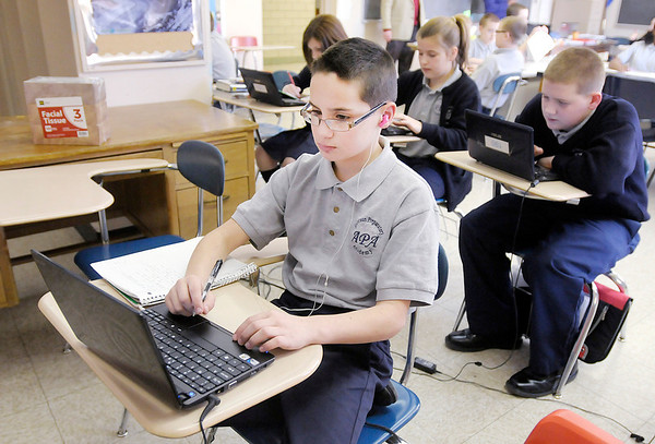 Preston McNeal, 12, works on his computer in his 6th grade Science class at the Anderson Preparatory Academy on Tuesday. Ball State has renewed APA's charter for a three year extension.