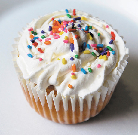 A Tres Leche cupcake is one of many selections at Jinny's Cupcakes at the food court in the Mounds Mall.