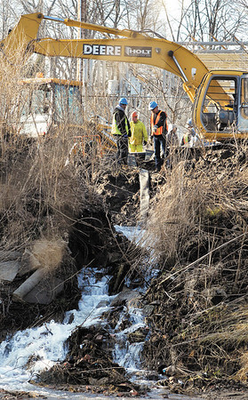 City of Anderson employees continued to work Thursday to repair a main water line leak that began Wednesday afternoon around 3 p. m. along White River near the Indian Trail Parkway and the Wheeler Ave. Water Department facility as the gushing water cascades down the river bank to White River.