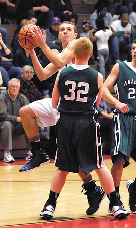 Elwood's Dakin Updegraff makes his move to the basket as Pendleton's Austin Brizendine moves in to take the charge.  An offensive charging foul was called on Updegraff.