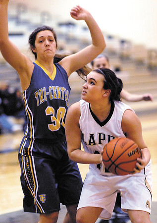 Lapel's Daniele Burnell looks to the basket as Tri-Central's Hadley DeWeese comes in to block her out from under the basket.