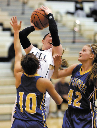 Lapel's Kirsten Rich goes up for a shot between two Tri-Central defenders.